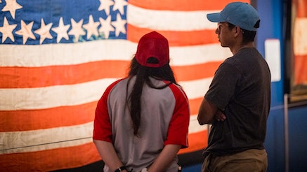 couple looking at a flag in the Flags and Founding Documents Exhibit