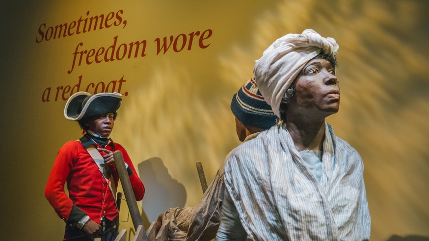 Finding Freedom tableau scene at the Museum depicting a British soldier of African descent trying to recruit a young boy of African descent to find freedom with the British army.