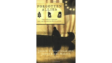 This image depicts the book cover of Forgotten Allies: The Oneida Indians and the American Revolution by Joseph T. Glatthaar and James Kirby Martin. The cover shows a sole Indian man in a canoe in the water. His back is toward the viewer and he is looking down. There is a 13-star American flag draped in the background of the cover.