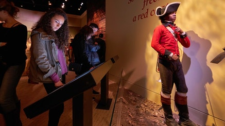 Guests interact with the Finding Freedom interactive in the galleries.