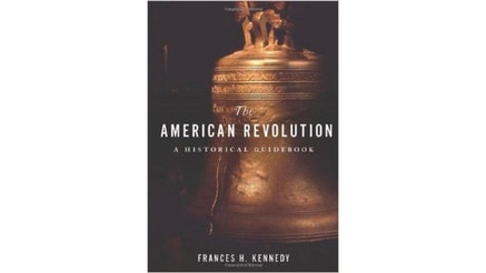 The image depicts the book cover of The American Revolution a Historical Guidebook. Frances H. Kennedy is the editor of the book. The book cover is a photograph of the Liberty Bell. The background is dark, but there is a stream of line illuminating some of the text written at the top of the bell. The crack of the bell is on the left side and is visible in the stream of light.