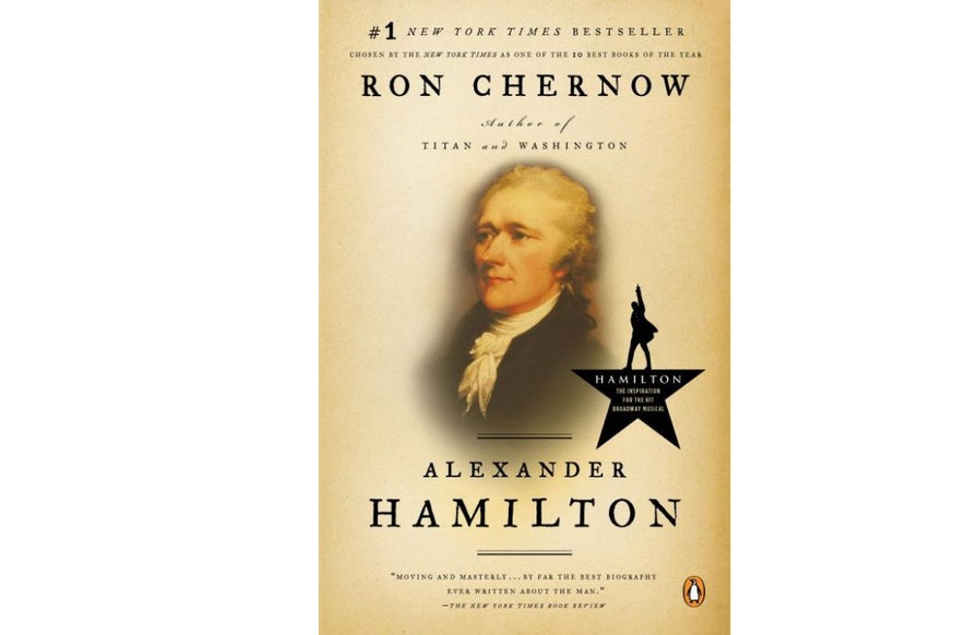 This image depicts the book cover of Alexander Hamilton by Ron Chernow. The cover is tan and the text is written in black. In the center, there is a portrait of Hamilton from the chest up.
