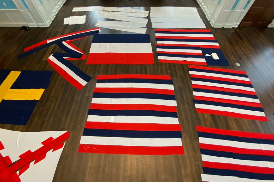 True Colours Flags laid out in liberty Hall at the Museum and photographed above from a lift