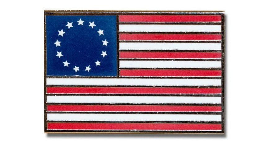 pin featured the 13-star American flag with 13 five-pointed stars in a circular pattern typically ascribed to Betsy Ross