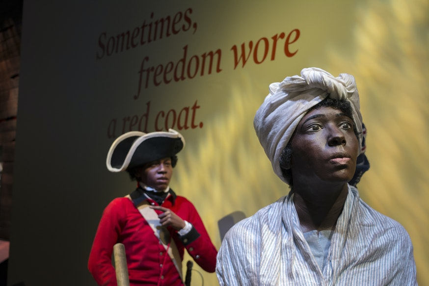 The Deborah and London Tableau figure at the Finding Freedom interactive in the galleries.
